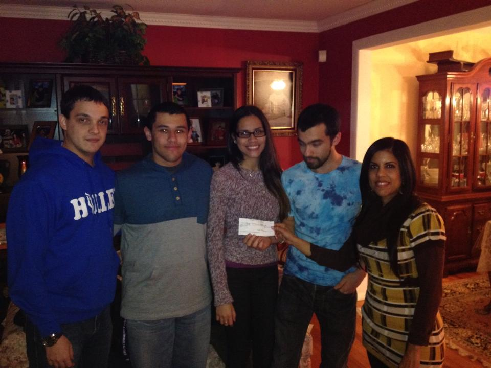 Beth giving check to CLDP kids