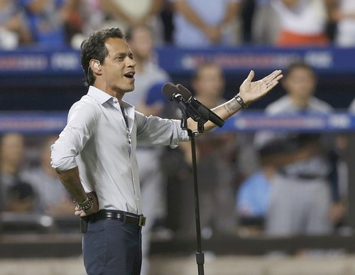 Marc Anthony sings God Bless America during the seventh inning stretch at Major League Baseball's All-Star Game in New York City